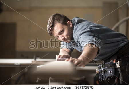 stock-photo-photo-of-male-wood-expert-checking-quality-of-board-367172570